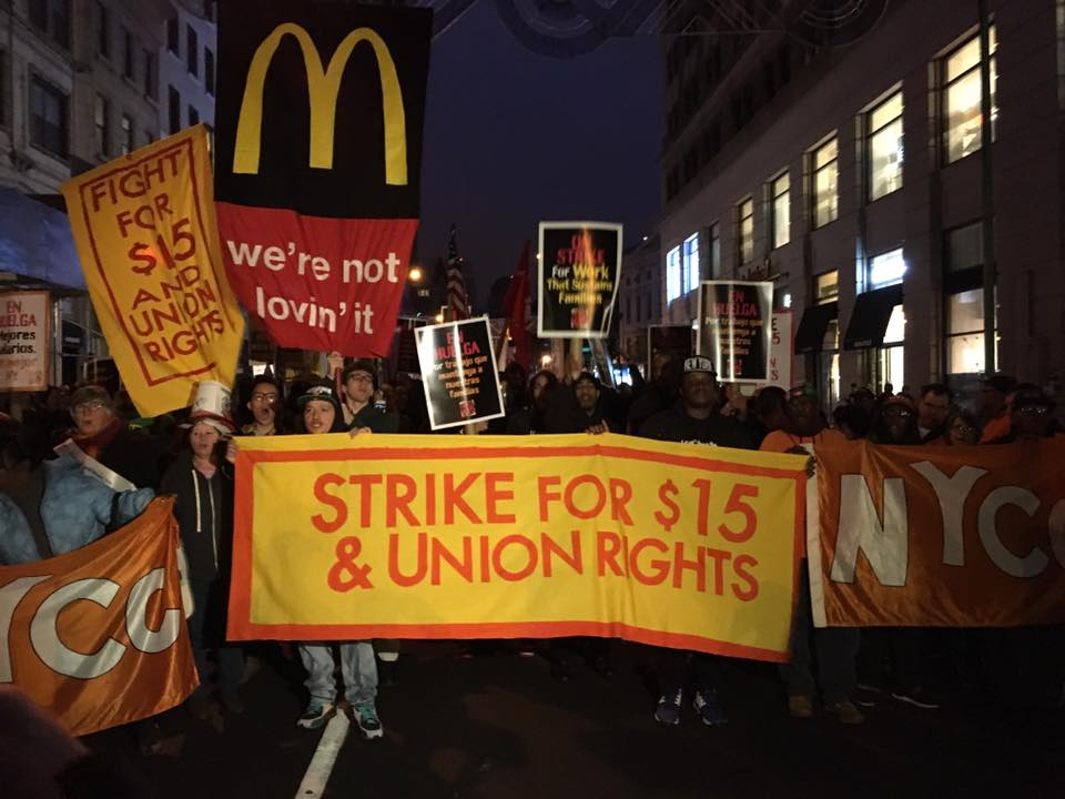 Workers rally in the early morning hours in Brooklyn, NY, as the nation's largest-yet Fight for $15 demonstrations get underway on Tuesday, November 10, 2015.